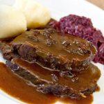 Sliced Sauerbraten with gravy.