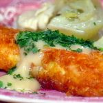 Fried cod with aioli sauce on top